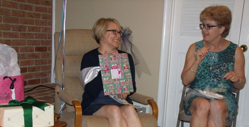 Jen gleefully opening her presents