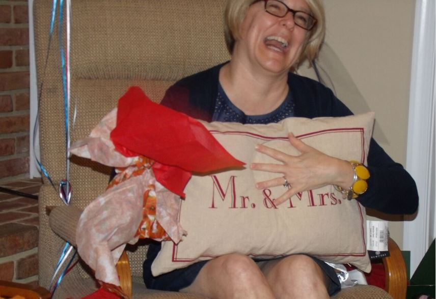 Jen opening her Mr & Mrs Pillow