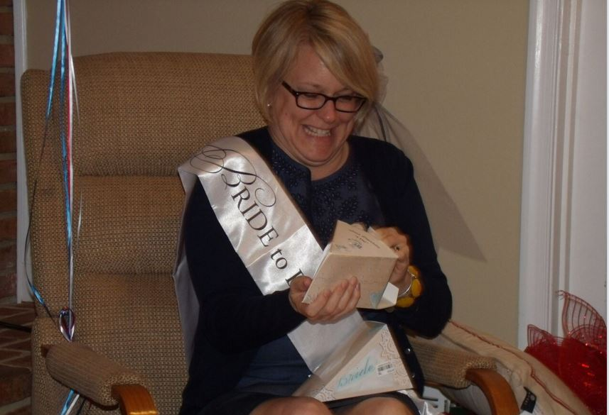 Jen opening her presents at the bridal shower