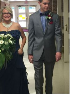 Jen and her son Jake walking her down the aisle
