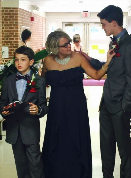 Jen and her two sons getting ready to start the wedding