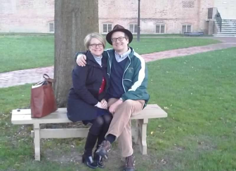 Picture of Jen & Eric sitting on a park bench